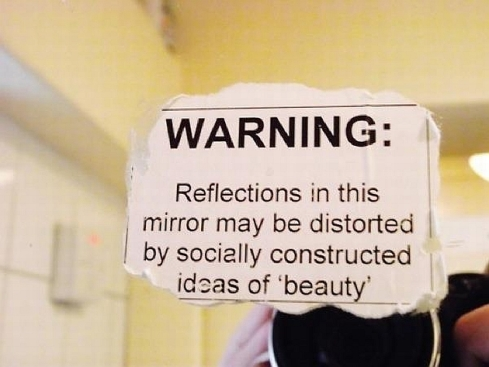 warning-reflections-in-this-mirror-may-be-distorted-by-socially-constructed-ideas-of-beauty